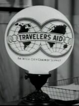 Travelers Aid Sign