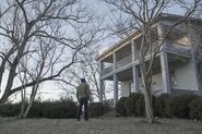Kyle Barnes standing outside of Joshua Austin's house