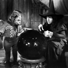 The Wicked Witch of the West with a Flying Monkey. (1939)
