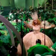 Glinda graces the Emerald City citizens with her presence.