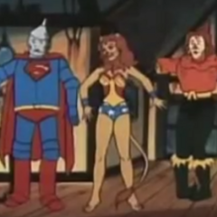 The Wicked Witch of the Worst Kind (Mr. Mxyzptlk) turned the super heroes to Oz characters. Superman (left) is the Tin Woodman, Wonder Woman (center) is the Cowardly Lion, and Aquaman (right) is the Scarecrow.