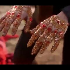 The Ruby Gloves (Emerald City's version of the Ruby Slippers aka the Sliver Shoes)