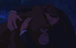 Tarzan releasing his stress by hugging Kala