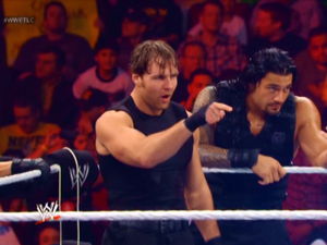16340 - Dean Ambrose Roman Reigns The Shield pointing tlc wwe