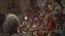 Aughra standing up to the Skeksis