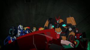 Bumblebee and his friends with defeated Simacore