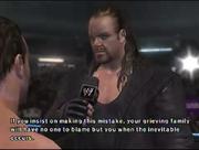 The Undertaker facing Chris Benoit