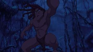 Tarzan smashes Clayton's gun to pieces