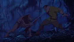 Tarzan snatches Clayton's gun and aims it at him