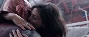 Vanessa and Deadpool Kiss