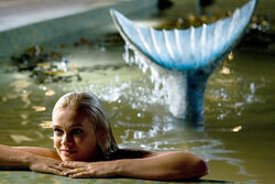 Aquamarine as a mermaid in the pool