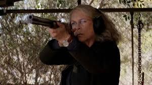 Laurie using a shotgun