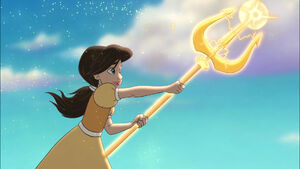Melody uses her grandfather's trident to dissolve the castle walls