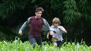 Zach and grey running from indomonious rex