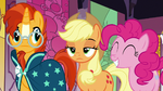 Applejack unamused; Pinkie Pie grinning blissfully S7E25
