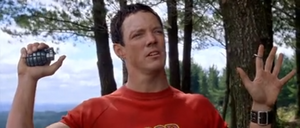 Jerry Conlaine (Matthew Lillard) in Without a Paddle holding a live grenade towards the sheriff and his henchmen