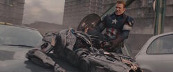 Captain-America-pulls-Ultrons-arm