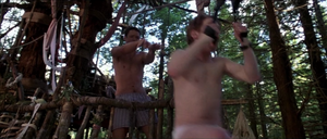 Jerry Conlaine (Matthew Lillard) in boxers giving a helpful push to Dr Dan Mott (Seth Green) in briefs in Without a Paddle