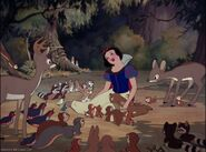 Snow White making friends with the forest animals