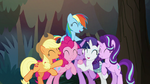 Twilight and her friends in a group hug S8E13