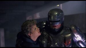 Anne Lewis rescuing Robocop from the traitor Lt. Hedgecock