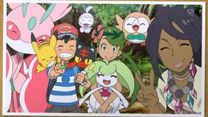 A Photo of Ash, Mallow, Olivia and Their Pokemon Friends