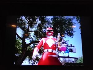 Red Ranger is holding a flasks of liquid