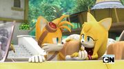Tails and Zooey holding hands after the rescue