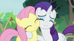 Fluttershy and Rarity nuzzling cheeks S8E4