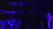 The Undertaker appears from the casket
