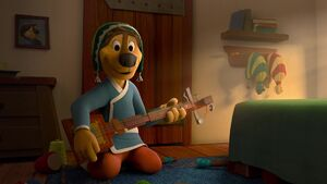 Bodi fixing his guitar