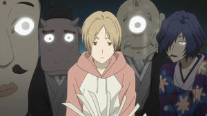 Natsume being stared by yokais