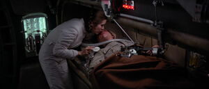 Princess Leia tending to Luke Skywalker after hes wounded by Darth Vader
