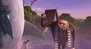 Gru punches Vector's shark