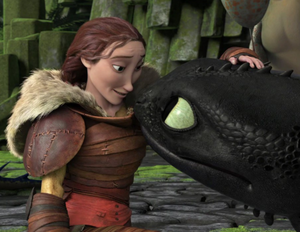 Valka tending to Toothless