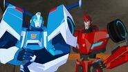 Sideswipe and Blurr.