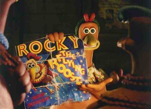 Ginger presenting Rocky's poster to the hens