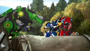 Bumblebee, Sideswipe, Fixit and Strongarm with Grimlock on Earth.