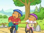 Brother and Sister ride bikes