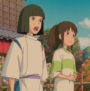 Chihiro and Haku facing Yubaba