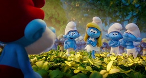 Papa seeing smurfette and her friends