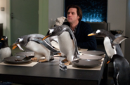 Popper at the table with the penguins
