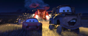 Lightning and Mater chased by Frank