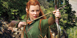 Tauriel poised to shoot an arrow