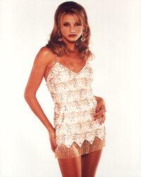 Tina Carlyle gold dress