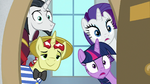 Twilight, Rarity, Flim, and Neighsay look inside S8E16