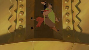 Kuzco and Pacha climbing the wall to retrieve the vial