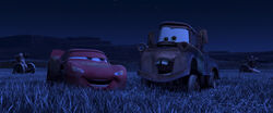 Lightning and Mater laughing while tractor tipping