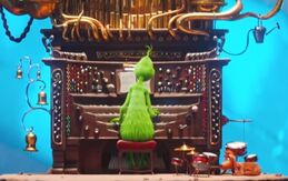 The Grinch playing music