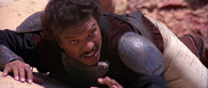 Lando Calrissian at the mercy of the Sarlacc